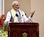"""PM Modi unveils the book """"Moving On... Moving Forward: A Year In Office"""""""
