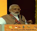 PM Modi addresses members of Women SHGs in Maharashtra