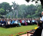 PM Modi meets officers and staff of PMO