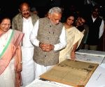 Modi lights the lamp to inaugurate an exhibition on making of the Constitution by the Constituent Assembly