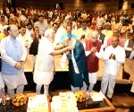 PM Modi felicitates BJP president Amit Shah