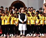 PM Modi meets underprivileged students from Wardha