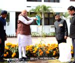 Modi plants a sapling at Governor House