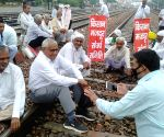 Free Photo: Protesters sit on rail tracks in Punjab, Haryana; commuters hit