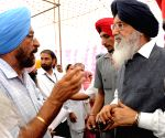 Parkash Singh Badal interacts with people