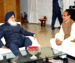 Parkash Singh Badal congratulates Shivraj Singh Chouhan for winning Madhya Pradesh assembly elections