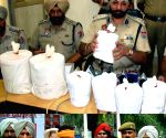 Punjab Police officers from Rular showing 4 Kg's of heroin recovered