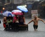 A water-logged street during heavy monsoon rain in Quezon City