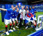 Rangers' fans blamed for vandalism, sectarian singing