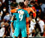 Real Madrid win in Valencia to go top as rivals slip up