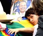 Thousands of Brazilians gathered in the northeastern city of Recife on Sunday to pay their respect to presidential candidate Eduardo Campos who was killed in a plane crash