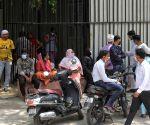Relative of a coronavirus victim mourns outside a mortuary of a COVID-19 hospital in New Delhi