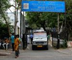 Relative of a coronavirus victim mourns outside a mortuary of LNJP COVID-19 hospital in New Delhi