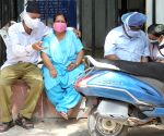 Relative of a coronavirus victim mourns outside a mortuary of a COVID-19 hospital (LNJP) in New Delhi