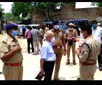 Former judge Agarwal visits Bikru village in UP