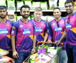 Rising Pune Supergiants players at a promotional event