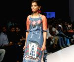 Acid attack survivor walks fashion runway in capital ()