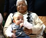 Lalu Yadav plays with his grandson