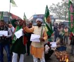 RJD joins trade unions strike in Bihar, workers block road with buffaloes