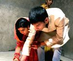 Rabri Devi performs rituals with son , daughter in-law