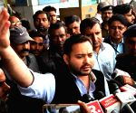 Tejashwi Yadav talks to the media