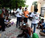RJD student activists distribute food, masks among the poor