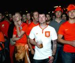 Fans watch the televised World Cup semi-final between the Netherlands and Argentina