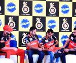 Virat Kohli, de Villiers during a promotional programme