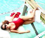 Salma Hayek looks fiery hot in monokini post