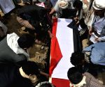 Yemenis bury a coffin of the soldier who was killed in the fighting with Shiite Houthi rebels in Yemen