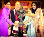 Ustad Amjad Ali Khan felicitated at Behala Classical Festival