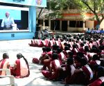 School students listens to Modi's speech on stress free examinations