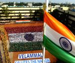 School students sit in tricolor formation