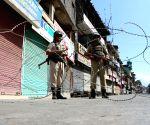 Security personnel enforce curfew