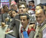 Senior citizens stand in a queue