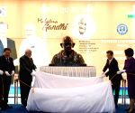 Modi unveils Gandhi bust, invokes his ideals to fight terror