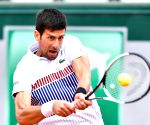 Djokovic battles past Cilic, goes undefeated in ATP Finals round-robin play