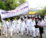 SGPC protest against desecration of holy book