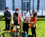 Shimla : Himachal Pradesh Governor Bandaru Dattatreya presented fruits and sweets to the Muslim brothers and sisters  at Raj Bhavan, Himachal Pradesh Source : TS_SI