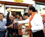 Shiv Sena activists distribute earthen diyas