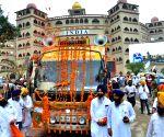 Attari (Punjab): Sikh devotees cross Attari-Wagah border during International 'Nagar Kirtan