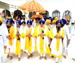 Attari (Punjab): International Nagar Kirtan organised during 550th birth anniversary celebrations of Guru Nanak Dev