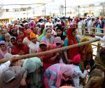 Sikh devotees visit the Golden Temple on the occasion of Baisakhi festival in Amritsar