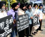 Sikhs' demonstrate against  desecration of Guru Granth Sahib