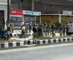 Militants kill two policemen in J&K