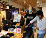 Stores reopen at Connaught Place with absence of buyers