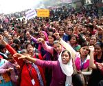 Students of Magadh Mahila College protest against blocking of a road leading to their college