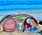 Sudarsan Pattnaik creates sand art for Sindhu, shuttler loves it