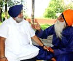 Sukhbir interacts with elderly protester to support farmers cause