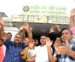 Supporters of Narsingh Pancham Yadav demonstrate outside NADA office